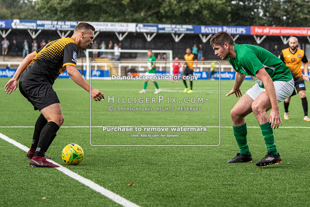 BROMLEY, UK - SEPTEMBER 22: Joseph Taylor, of Cray Wanderers FC, has a stand off with Cameron Watson, of Soham Town Rangers, during the Emirates FA Cup Second Round Qualifier match between Cray Wanderers and Soham Town Rangers at Hayes Lane on September 22, 2019 in Bromley, UK. <br /> (Photo: Jon Hilliger)