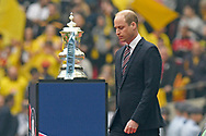HRH Prince William the Duke of Cambridge walks past the FA Cup as he prepares to be introduced to the teams ahead of the The FA Cup Final match between Manchester City and Watford at Wembley Stadium, London, England on 18 May 2019.