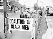 Coalition of Black Men, march on N. Killigsworth, Portand, Oregon, at the corner of Mississippi. 1988