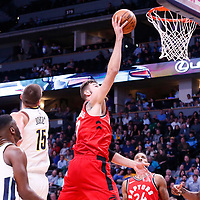 01 November 2017: Toronto Raptors center Jonas Valanciunas (17) goes for the layup past Denver Nuggets center Nikola Jokic (15) during the Denver Nuggets 129-111 victory over the Toronto Raptors, at the Pepsi Center, Denver, Colorado, USA.