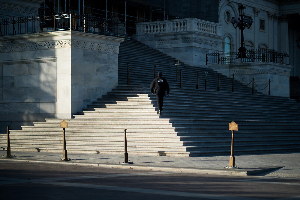 United States Secret Service members sweep the U.S. Capitol grounds before the casket of Former President George H.W. Bush arrives on Dec. 3, 2018.