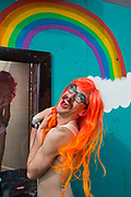 Harry Clayton-Wright in gay Troll character, Shangri La field, Glastonbury Festival 2016. The Glastonbury Festival is the largest greenfield festival in the world, and is now attended by around 175,000 people. Its a five-day music festival that takes place near Pilton, Somerset, United Kingdom. In addition to contemporary music, the festival hosts dance, comedy, theatre, circus, cabaret, and other arts. Held at Worthy Farm in Pilton, leading pop and rock artists have headlined, alongside thousands of others appearing on smaller stages and performance areas.