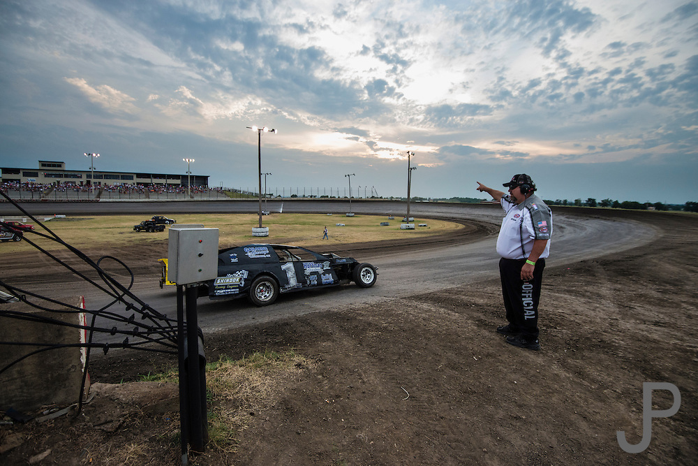 "Track official Jake Kelley from Glenpool, OK monitors the qualifying laps and acts as ""traffic cop"" for racers entering and leaving the race track."