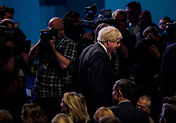 © Licensed to London News Pictures. 04/10/2017. Manchester, UK. British foreign minister BORIS JOHNSON arrivesin the conference hall to listen to prime minister THERESA MAY deliver her leaders speech on the final day of the Conservative Party Conference. The four day event is expected to focus heavily on Brexit, with the British prime minister hoping to dampen rumours of a leadership challenge. Photo credit: Ben Cawthra/LNP