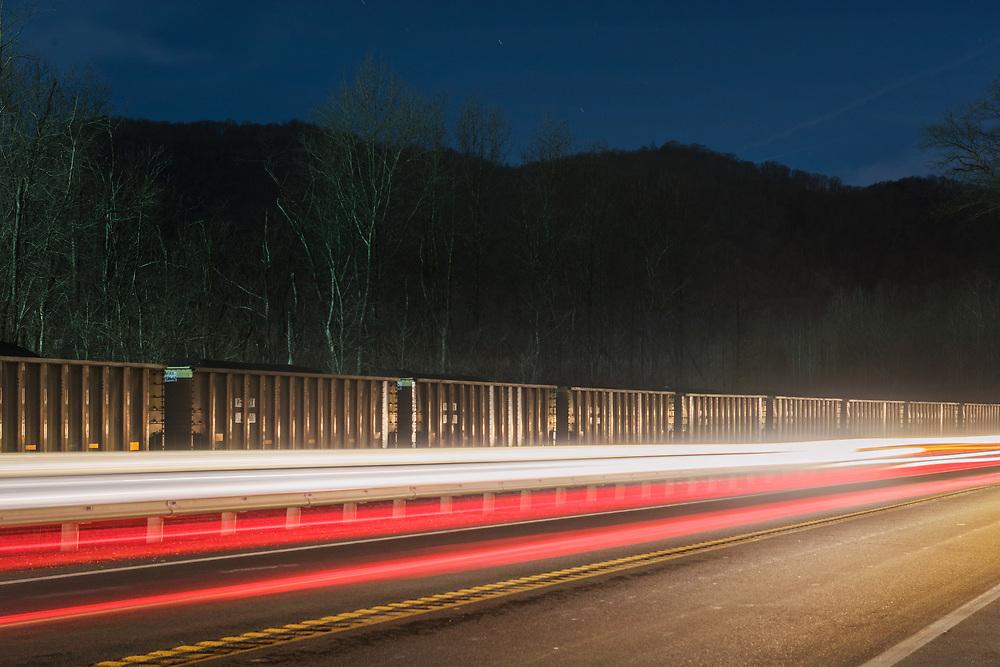 Car lights illuminate a stationary coal train near the Mammoth Coal Processing Plant. Kanawha Valley, West Virginia.