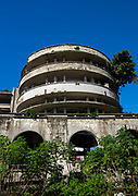 """Beira Grande Hotel,  Hell with 5 Stars <br /> <br /> Built in 1954, the Beira Grande Hotel was once the most luxurious hotel in Africa The giant  complex had around 120 suites, a cinema, an Olympic swimming pool, a helicopter pad,  restaurants, a bank, a post office - it was a city in itself. Since shutting down, this colonial <br /> dream has become a nightmare. After being used initially as military <br /> base during the civil war, the squatters moved in. Thousands of impoverished people now crowd the Grande Hotel, it being the only place they can find shelter. The living conditions are atrocious. <br /> Drugs, disease, and trash are ubiquitous. People have removed much<br /> of the plumbing, electrical, windows and even concrete to sell on the black market. This weakens the building but provides them with another meal. The parquet floor was used as fuel for cooking, so all <br /> that is left now is the cold, unwelcoming structure they call home. Children play around open elevator shafts with no elevator in sight. <br /> """"No one knows when the building is going to collapse,<br /> """" says one resident, Its going to collapse on top of our poverty""""<br /> Despite the abhorrent conditions, there is an element on community here. All are poor, but poor together. Newcomers are always welcome and mutual respect is one of the few laws in this house of misery. <br /> It was really the pinnacle of luxury, meant for wealthy businessmen and tourists. For its massive size, 120 rooms is really not much. Turns out there was no demand so they shut it down in 1963. It never made a profit.  After closing, the pool still remained open. The Mozambican Olympic Swimming Team trained there. Now it used by inhabitants for bathing or washing laundry. After the civil war, it became a refugee camp. The people who live there have mostly emigrated from the mine-filled countryside.  As of 2008, it housed 1,077 inhabitants with large families sharing one room. Now there is between 2,000 and 3,00"""