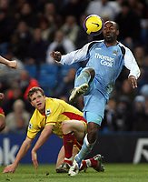 Photo: Paul Thomas.<br /> Manchester City v Watford. The Barclays Premiership. 04/12/2006.<br /> <br /> Darius Vassell (R) of Man City gets past Jay Demerit of Watford.