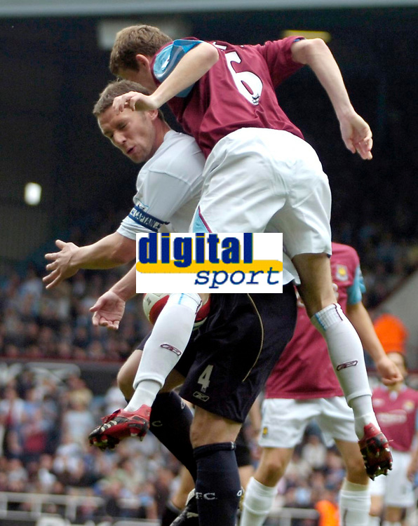 Photo: Ed Godden/Sportsbeat Images.<br /> West Ham United v Bolton Wanderers. The Barclays Premiership. 05/05/2007. West Ham's George McCartney (R), climbs high above Kevin Nolan.