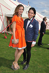 MARGO STILEY and RICHARD DENNAN at the 27th annual Cartier International Polo Day featuring the 100th Coronation Cup between England and Brazil held at Guards Polo Club, Windsor Great Park, Berkshire on 24th July 2011.