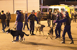 © licensed to London News Pictures. Manchester, UK  23/02/2012. Police use dogs to separate rival fans outside Old Trafford ahead of the Manchester United vs Ajax Amsterdam 2nd leg match in the Europa League. Photo credit should read Joel Goodman/LNP