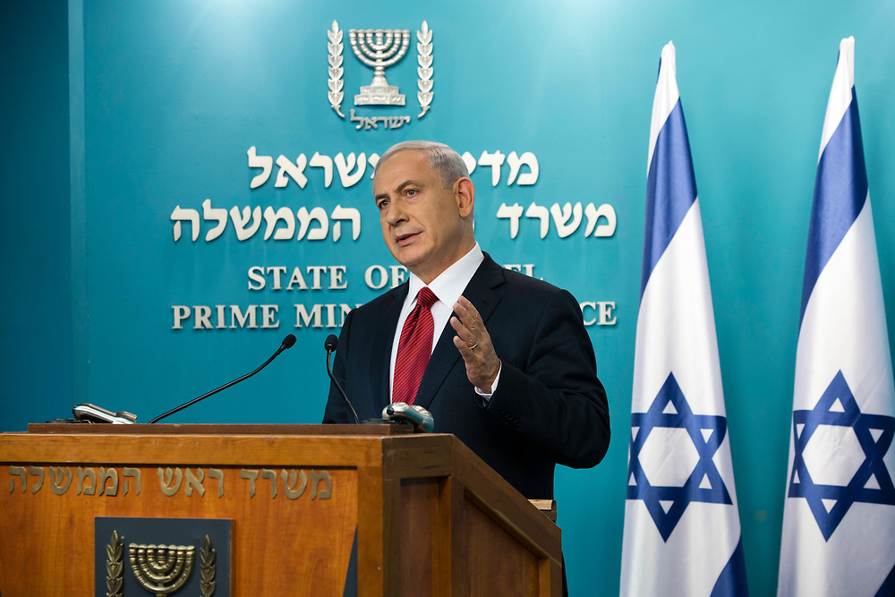 Israel's Prime Minister Benjamin Netanyahu delivers a statement to the media at the Prime Minister's Office in Jerusalem, Israel, on November 18, 2014, following today's terror attack in which two Palestinian men armed with axes, knives and guns attacked worshippers praying inside a Synagogue in Jerusalem, killing four Jewish men.