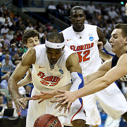 Mar 24, 2011; New Orleans, LA; Florida Gators forward Alex Tyus (23) and Brigham Young Cougars guard Kyle Collinsworth (31) scramble for a loose ball during the first half of the semifinals of the southeast regional of the 2011 NCAA men's basketball tournament at New Orleans Arena.  Mandatory Credit: Derick E. Hingle