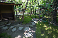 Stepping Stones at Rakusui-en  - Rakusui was the pen name of Hakata businessman Mr Chikamasa Shimozawazenemon, who contributed to the development of Fukuoka.  In 1906, Chikamasa built Sumiyoshi villa with a teahouse in this area.  In 1995 the city of Fukuoka remodeled the garden and teahouse and opened the venue and named it Rakusui-en echoing its original name Rakusuian - a place where visitors can experience tea ceremony chado.  Its most famous feature are its distinctive walls. The clay walls are made of reclaimed burnt  roof tiles and rocks and from the war,  called Hakatabei.