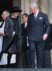 © Licensed to London News Pictures. 14/12/2017. London, UK. Camilla, Duchess of Cornwall and Prince Charles leave St Paul's Cathedral after attending the Grenfell Tower National Memorial Service mark the six month anniversary of the fire. The service was attended by survivors and relatives of those who lost their lives in the fire, as well as members of the emergency services and members of the Royal family. 71 people were killed when a huge fire ripped though 24-storey Grenfell Tower block in west London in June 2017. Photo credit: Peter Macdiarmid/LNP