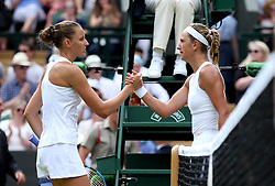 Karolina Pliskova and Victoria Azarenka (right) shake hands after their match on day three of the Wimbledon Championships at the All England Lawn Tennis and Croquet Club, Wimbledon.