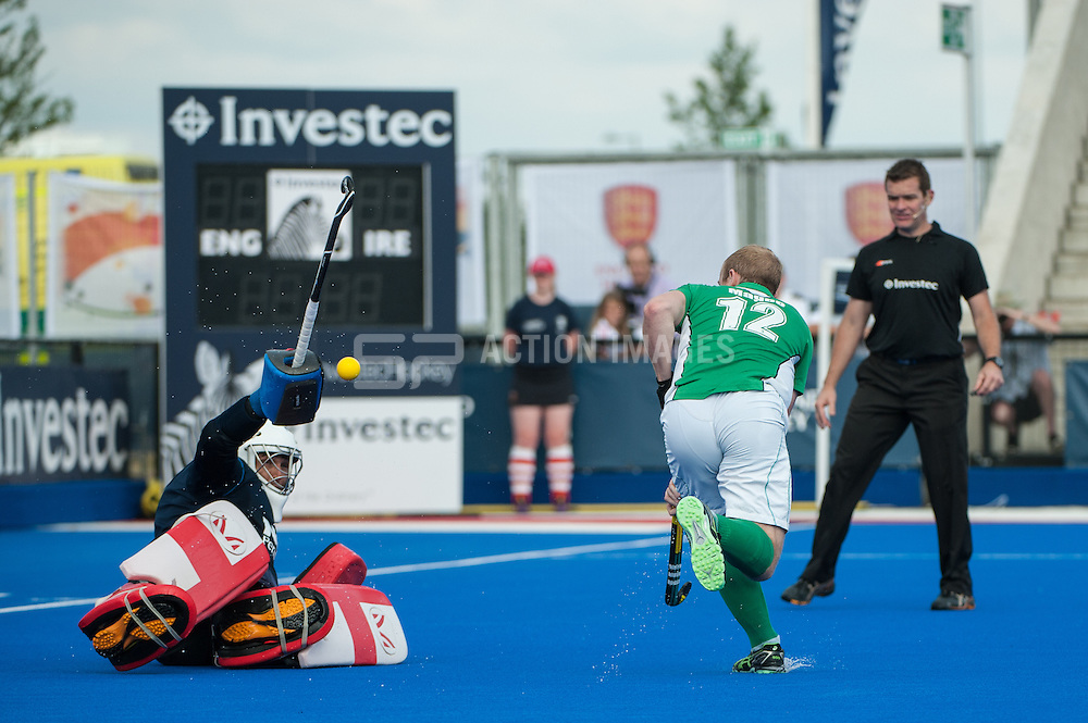 England's George Pinner saves from Eugene Magee of Ireland during the penalty shoot-out. Final of the Investec London Cup, Lee Valley Hockey & Tennis Centre, London, UK on 13 July 2014. Photo: Simon Parker