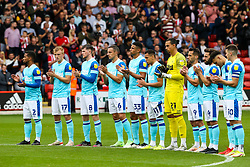 Derby County players during the minutes applause during the Sky Bet Championship match at Bramall Lane, Sheffield. Picture date: Saturday September 25, 2021.