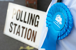 © Licensed to London News Pictures. 02/05/2019.<br /> Swanley,UK. Conservative rosette, Voting at Christ Church Youth and Family Centre in Swanley, Kent. Polling stations are open across England and Northern Ireland for Local elections today. Photo credit: Grant Falvey/LNP