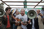 Moscow, Russia, 22/08/2010. .Performers sing through megaphones in Pushkin Square, where some 3,000 people gathered for a concert and protest against the destruction of part of Khimki Forest in northern Moscow as part of a motorway project. The concert was banned and police seized the performers' musical equipment, but unusually the anti-government protest was allowed to take place, although a number of opposition organisers were arrested on their way to the demonstration.