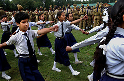Kashmiri children dressed symbolically in uniforms from the colonial era participate in India's main official Independence Day ceremony that passed  peacefully in the summer capital of Srinagar,  August 15, 2002. The ceremony was held in Srinagar's Bakshi Stadium which had been ringed by local and federal police, border guards and Indian army soldiers to prevent militant strikes.