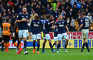 Jamie Philpot celebrates scoring Millwall's second goal during the Sky Bet Championship match between Wolverhampton Wanderers and Millwall at Molineux, Wolverhampton, England on 2 May 2015. Photo by Alan Franklin.