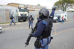 South Africa - Cape Town - 05 October 2020 - The accused in Western Cape top cop Lieutenant-Colonel Charl Kinnear's murder is whisked away in a Nyala which was heavily guarded behind the gate of the courthouse. The man arrested after the assassination of the Western Cape's top cop Lieutenant-Colonel Charl Kinnear made his second appearance in court on Monday morning. The suspect, Zane Killian, 39, appeared in the Bishop Lavis Magistrate's Court on charges of murder, conspiracy to commit murder and unlawful interception of communication. Kinnear was shot and killed outside his home. It is alleged to have been hit. Killian is believed to have traced Kinnear through his phone. The case was postponed to Friday. Picture: Henk Kruger/African News Agency(ANA)