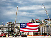 11 JUNE 2019 - COUNCIL BLUFFS, IOWA: A giant American flag at Southwest Iowa Renewable Energy Tuesday. President Trump visited Southwest Iowa Renewable Energy in Council Bluffs Tuesday to announce that his administration was relaxing rules on E15, an ethanol additive for gasoline. Iowa is one of the leading ethanol producers in the U.S. and Iowa corn farmers hope the administration's change in E15 rules will spur demand for corn.         PHOTO BY JACK KURTZ