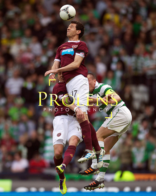 William Hill Scottish FA Cup Semi Final CELTIC FC v HEART OF MIDLOTHIAN FC Season 2011-12.15-04-12...HEARTS RYAN MCGOWAN WINS THE HEADER  during the William Hill Scottish FA Cup Semi Final tie between CELTIC FC and HEART OF MIDLOTHIAN FC with the Winner facing   in this years Scottish Cup Final in May...At Hampden Park Stadium , Glasgow..Sunday 15th April 2012.Picture Mark Davison/ Prolens Photo Agency / PLPA
