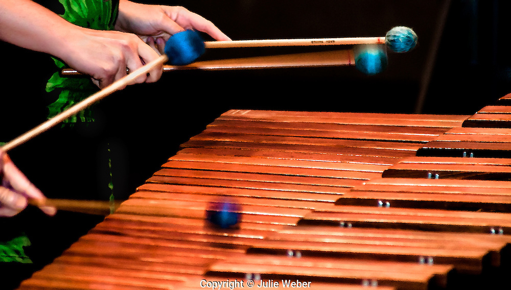 """A viiid,colorful image rendered in a painterly style of a duet being played on an orchestral marimba. <br /> <br /> For IMAGE LICENSING just click on the """"add to cart"""" button above.<br /> <br /> Fine Art archival paper prints for this image as well as canvas, metal and acrylic prints available here:<br /> https://2-julie-weber.pixels.com/featured/2-duet-julie-weber.html"""