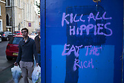 Kill all hippies Eat the rich graffiti in Shoreditch. Slogans of social comment.
