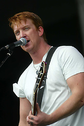 Josh Homme of Queens of the Stone Age, the American rock band, on the main stage on Sunday 10th July, 2005 at the two-day T in the Park festival, at Balado, Kinross-shire, Scotland..