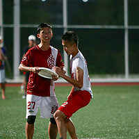 Nanyang Poly (white top) defeated Temasek Poly 10-8 in the gold medal game to win the POL-ITE Ultimate Championship. (Photo © Les Tan/Red Sports)