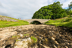 © Licensed to London News Pictures. 12/06/2018. Yokenthwaite UK. A stretch of the River Wharf has dried up in Yokenthwaite in the Yorkshire Dales due to the recent lack of rain causing fears of a possible drought. Britain could be heading for a three month heatwave with temperatures hitting 29c by July. Photo credit: Andrew McCaren/LNP