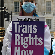 Downing Street, London, UK. 6 August 2021. Trans Rights Protest our identity is not negotiable against Boris Johnson's government is complicit in an increasing threat towards transgender and non-binary people.