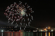 Beacon, New York -  Independence Day fireworks explode in the sky over Newburgh and are reflected in the Hudson River as seen from a waterfront park on July 4, 2010. ©Tom Bushey / The Image Works