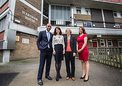 © Licensed to London News Pictures. 20/07/2015. London, UK. Labour leadership contender Liz Kendall (second left) with Chuka Umunna (far left) Emma Reynolds (second right) and Gloria De Piero (far right) at Roupell Park Estate in Brixton to talk about renewable energy. Photo credit : James Gourley/LNP