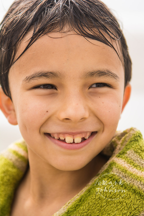 Portrait of smiling 8 year old Eurasian boy, Oregon, USA people ****Model Release available