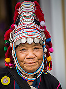 02 DECEMBER 2014 - BANGKOK, THAILAND: An Akha hilltribe person on Sanam Luang in Bangkok before the Trooping of the Colors, during a celebration of the King's Birthday. The Thai Royal Guards parade, also known as Trooping of the Colors, occurs every December 2 in celebration of the birthday of Bhumibol Adulyadej, the King of Thailand. The Royal Guards of the Royal Thai Armed Forces perform a military parade and pledge loyalty to the monarch. Historically, the venue has been the Royal Plaza in front of the Dusit Palace and the Ananta Samakhom Throne Hall. This year it was held on Sanam Luang in front of the Grand Palace.    PHOTO BY JACK KURTZ