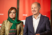 German Minister of Finance and SPD Chancellor candidate Olaf Scholz (R) poses for a picture next to a supporter during an elections campaign event in Berlin, Germany, September 03, 2021. The German Federal elections are scheduled to take place on September 26, 2021.