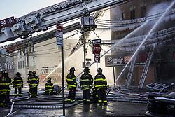 January 2, 2018 - Bronx, New York, United States - NDNY firefighters battle 7 alarm fire on Tuesday Jan. 2, 2018 in the Bronx, NY.Fire broke just before 6 am in Tuesday morning injuring at least 23 people...1/2/2018.Bronx, NY..Go Nakamura/Zuma press (Credit Image: © Go Nakamura via ZUMA Wire)