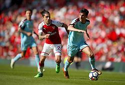 Arsenal's Hector Bellerin (left) and Burnley's Jack Cork battle for the ball