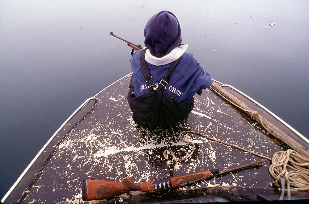 Native hunter awaiting a seal.