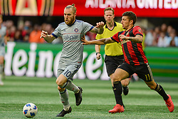 October 21, 2018 - Atlanta, GA, U.S. - ATLANTA, GA Ð OCTOBER 21:  Chicago's Aleksandar Katai (10) battles with Atlanta's Eric Remedi (11) during the match between Atlanta United and the Chicago Fire on October 21st, 2018 at Mercedes-Benz Stadium in Atlanta, GA.  Atlanta United FC defeated the Chicago Fire by a score of 2 to 1.  (Photo by Rich von Biberstein/Icon Sportswire) (Credit Image: © Rich Von Biberstein/Icon SMI via ZUMA Press)