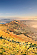 A frosty winter dawn breaks over the Great Ridge from Mam Tor, Peak District