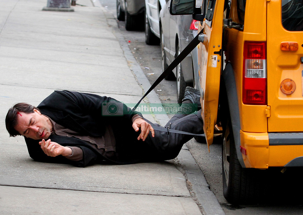 """Javier Bardem and Elle Fanning are seen filming an intense dramatic scene on the set of their upcoming movie """"Molly"""" in Brooklyn. The scene involved Javier getting tangled and struggling to get out of a cab where he falls face first to the ground and bleeds from the forehead as his costar Elle Fanning is seen holding him and crying out for help. Javier will be playing a mental person and will be the father of his costar Elle Fanning. 16 Jan 2019 Pictured: Javier Bardem. Photo credit: LRNYC / MEGA TheMegaAgency.com +1 888 505 6342"""