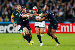 South Africa replacement Schalk Brits is tackled by USA Fly-Half Shalom Suniula - Mandatory byline: Rogan Thomson/JMP - 07966 386802 - 07/10/2015 - RUGBY UNION - The Stadium, Queen Elizabeth Olympic Park - London, England - South Africa v USA - Rugby World Cup 2015 Pool B.