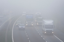 © Licensed to London News Pictures. 07/12/2020. <br /> Swanley, UK. Traffic on the M25 in Kent near Swanley. The Met Office has issued a yellow weather warning for the UK from the South coast to the Midlands for freezing foggy weather conditions with low visibility in some places. Photo credit:Grant Falvey/LNP