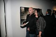 MR. AND MRS. RUSLAN FOMICHEV, Helmut Newton XL. Hamiltons. Carlos Place. London. 25 September 2007. -DO NOT ARCHIVE-© Copyright Photograph by Dafydd Jones. 248 Clapham Rd. London SW9 0PZ. Tel 0207 820 0771. www.dafjones.com.