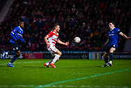 Herbie Kane of Doncaster Rovers (15) brings the ball down with George Edmundson of Oldham Athletic (4) blocking his shot during the The FA Cup fourth round match between Doncaster Rovers and Oldham Athletic at the Keepmoat Stadium, Doncaster, England on 26 January 2019.