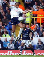 Fotball<br /> Premier League 2004/05<br /> Tottenham v Newcastle<br /> 10. april 2005<br /> Foto: Digitalsport<br /> NORWAY ONLY<br /> Spurs's Frederic Kanoute gets up ahead of Newcastle's Celestine Babayaro